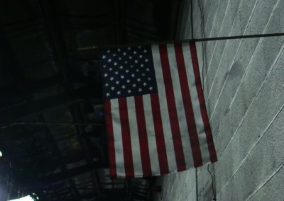 American flag hung from the wall in production area